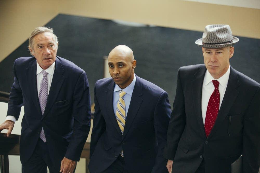 Noor with attorneys